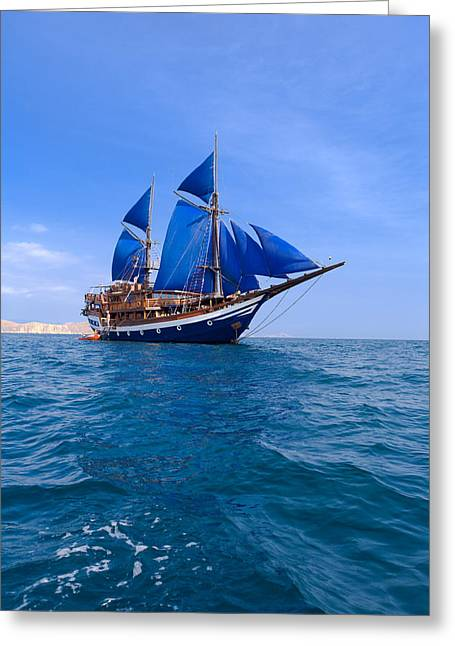 Historic Schooner Greeting Cards - Vintage Wooden Ship with Blue Sails near Komodo Greeting Card by Rostislav Ageev