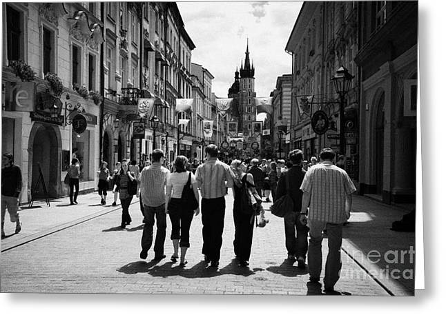 Polish City Greeting Cards - Visitors Walking Down The Ulica Florianska Street Leading Down From City Gates To Old Town City Centre Krakow Greeting Card by Joe Fox