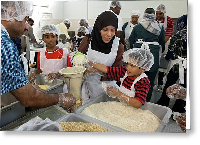 Volunteers Preparing Meal Packages Greeting Card by Jim West