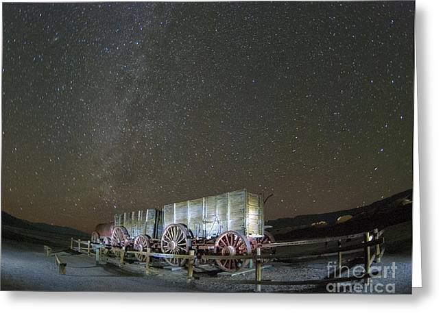 Death Valley National Park Greeting Cards - Wagon Train Under Night Sky Greeting Card by Juli Scalzi