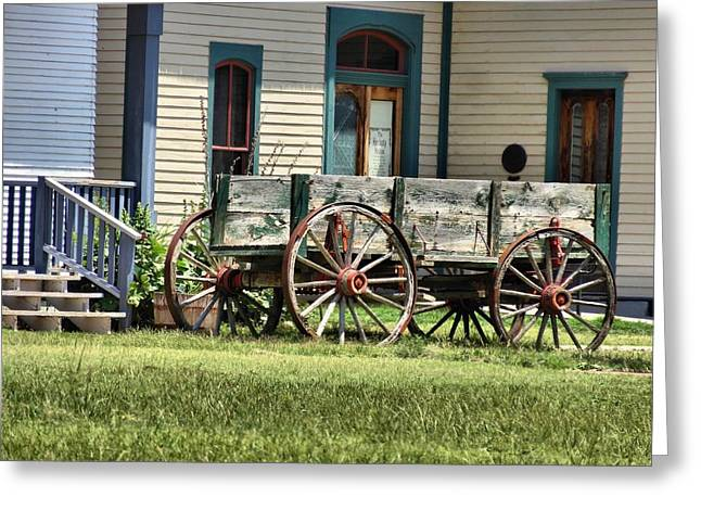 Wooden Wagons Greeting Cards - Wagon Wheels In Dodge City Greeting Card by Dan Sproul