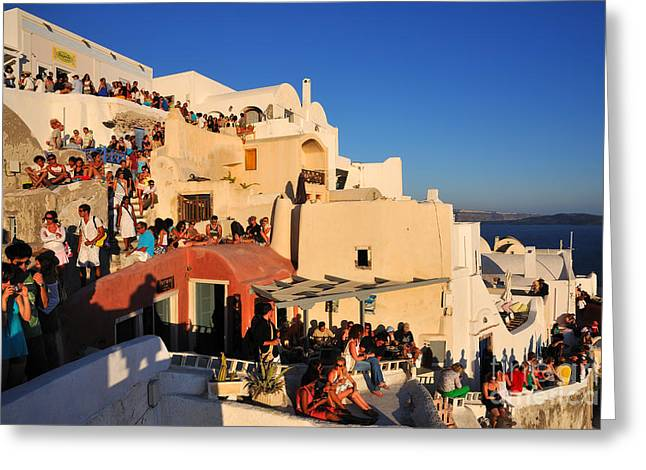 Village Greeting Cards - Waiting for the sunset in Oia town Greeting Card by George Atsametakis