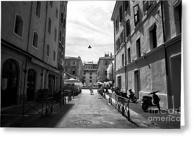 D.w Greeting Cards - Walking Alone in Marseille Greeting Card by John Rizzuto