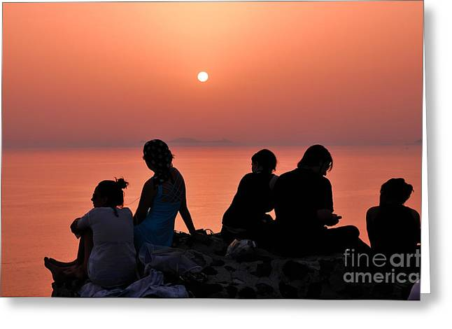 Greece Greeting Cards - Watching the famous sunset in Oia Greeting Card by George Atsametakis