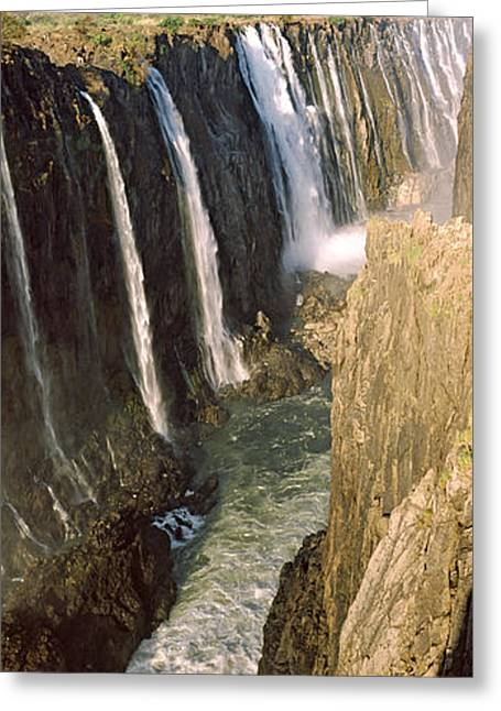 Zimbabwe Photographs Greeting Cards - Water Falling Through Rocks In A River Greeting Card by Panoramic Images