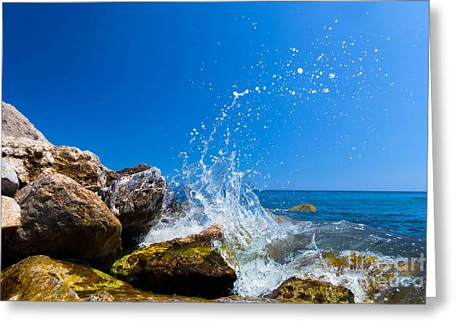 Perissa Greeting Cards - Waves hitting rocks on a tropical beach Greece Santorini Greeting Card by Michal Bednarek