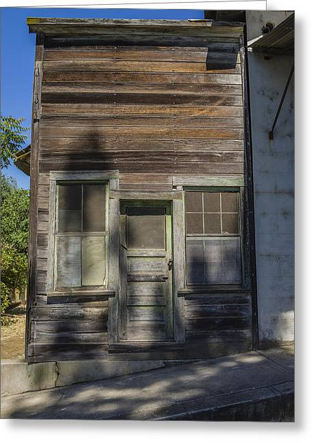 False Front Buildings Greeting Cards - Weathered wooden building Greeting Card by David Litschel