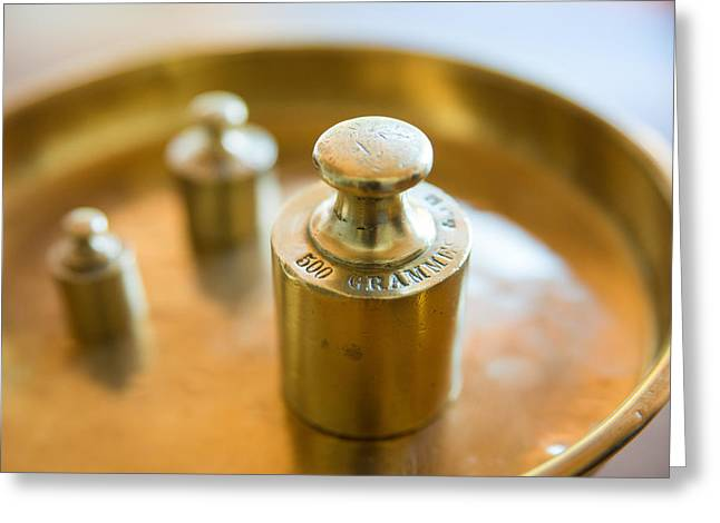 Nostalga Greeting Cards - Weights in a golden scale pan  Greeting Card by Matthias Hauser