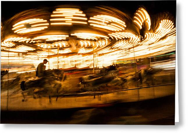 Go Daddy Greeting Cards - Whirling carousel with rider Greeting Card by Aaron Baker
