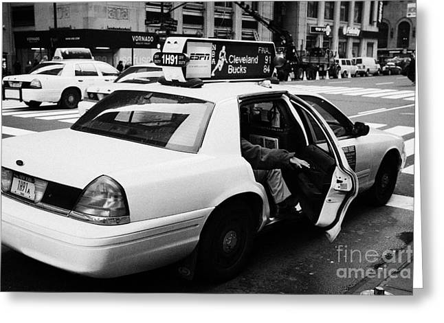 Manhatan Greeting Cards - white caucasian passenger closes rear door of yellow cab on taxi rank at crosswalk on 7th Avenue Greeting Card by Joe Fox