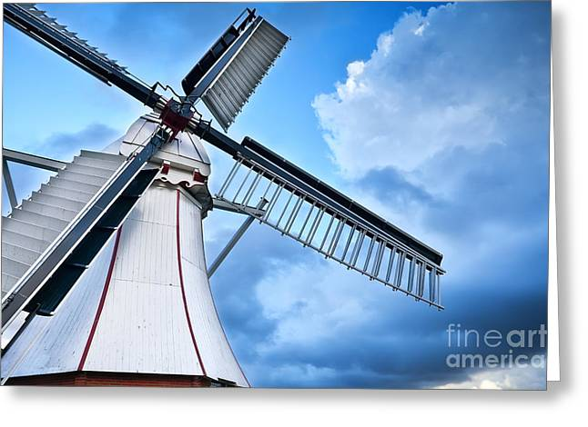 Wooden Building Greeting Cards - white Dutch windmill over blue sky Greeting Card by Olha Rohulya