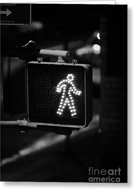 White Man Pedestrian Walk Sign Illuminated At Night New York City Usa Greeting Card by Joe Fox