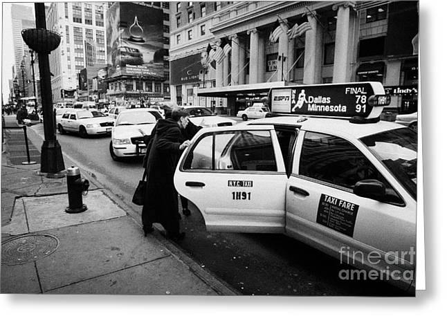 Manhatan Greeting Cards - white middle aged passengers exit from yellow cab rear door at taxi rank on 7th Avenue Greeting Card by Joe Fox