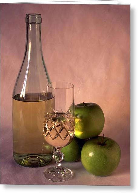 Sake Bottle Greeting Cards - White wine and apples on painted background Greeting Card by IB Photo
