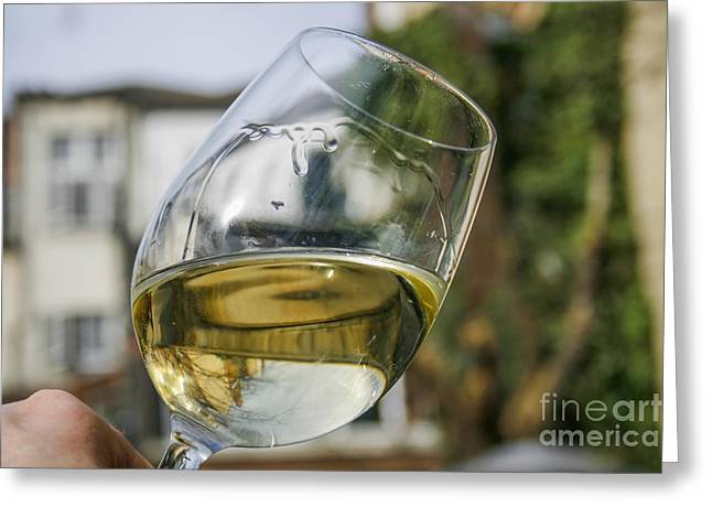 Goblet Greeting Cards - White wine swirling in a glass Greeting Card by Patricia Hofmeester
