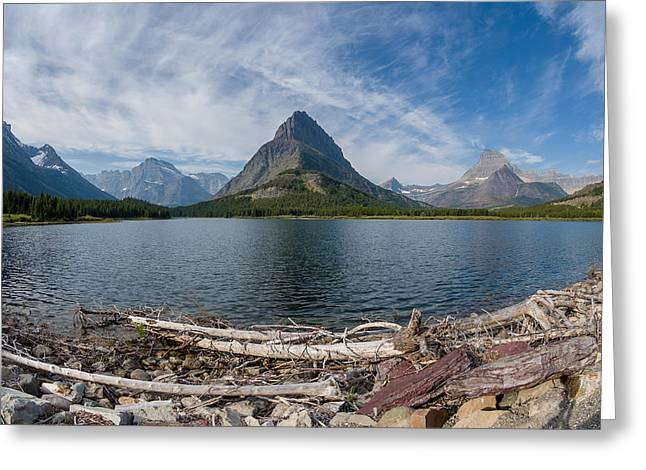 Reflection In Water Greeting Cards - Wide View of Swiftcurrent Lake Greeting Card by Greg Nyquist