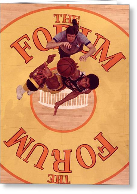 Sports Photography Greeting Cards - Wilt Chamberlain Vs. Kareem Abdul Jabbar Tip Off Greeting Card by Retro Images Archive