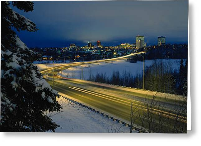 Winter Night Greeting Cards - Winding Road Running Through A Snow Greeting Card by Panoramic Images