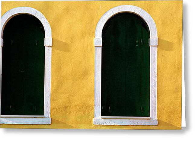 Image Repeat Greeting Cards - Windows In Yellow Wall Venice Italy Greeting Card by Panoramic Images
