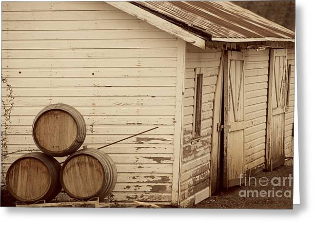Winery Photography Greeting Cards - Wine Barrels and Rustic White Barn Greeting Card by Juli Scalzi