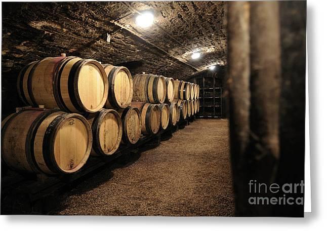 Wine barrels in a cellar. Cote d'Or. Burgundy. France. Europe Greeting Card by BERNARD JAUBERT