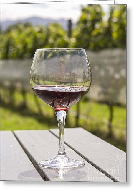 Table Wine Greeting Cards - Wineglass with red wine in vineyard Greeting Card by Patricia Hofmeester