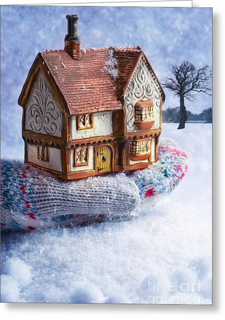 Winter Night Greeting Cards - Winter Cottage In Gloved Hand Greeting Card by Amanda And Christopher Elwell