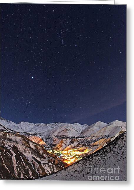 Snowy Night Night Greeting Cards - Winter Stars Over Iranian Village Greeting Card by Babak Tafreshi