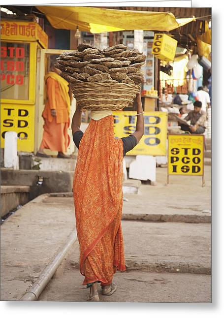 Balance In Life Greeting Cards - Woman Carrying Cow Dung In Basket On Greeting Card by Paul Miles