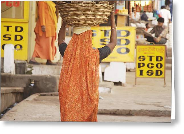 Woman Carrying Cow Dung In Basket On Greeting Card by Paul Miles