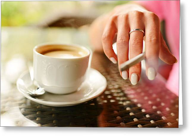 Coffee Drinking Greeting Cards - Woman drinking coffee and smoking in outdoors cafe Greeting Card by Anna Bryukhanova