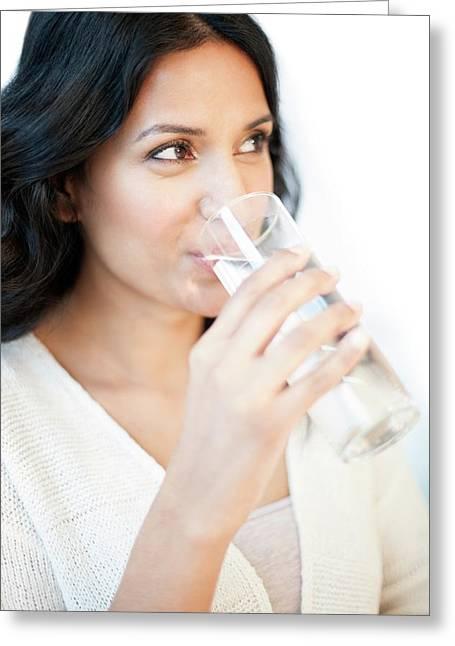Woman Drinking Water Greeting Card by Ian Hooton