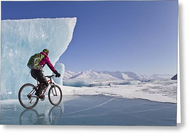 Fat Tire Greeting Cards - Woman Fat Tire Mountain Biking On Ice Greeting Card by Joe Stock