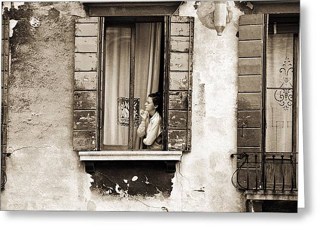 Woman gazing out of a window contemplating Greeting Card by Stephen Spiller