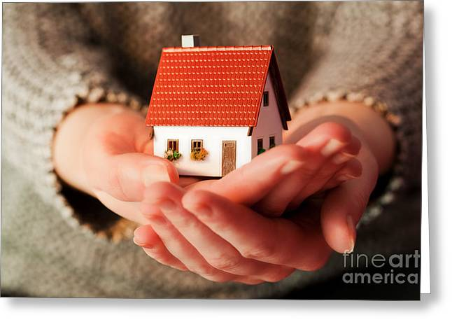 Rent House Greeting Cards - Woman holding a small new house in her hands Greeting Card by Michal Bednarek