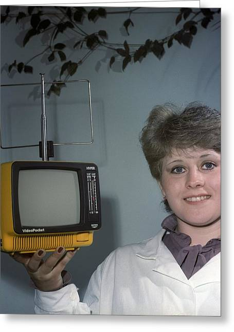 Union Square Greeting Cards - Woman holding a small television Greeting Card by Science Photo Library