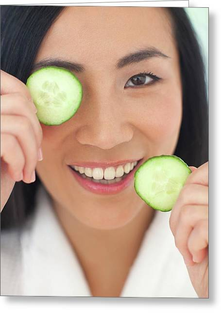 Woman Holding Cucumber Slices Greeting Card by Ian Hooton