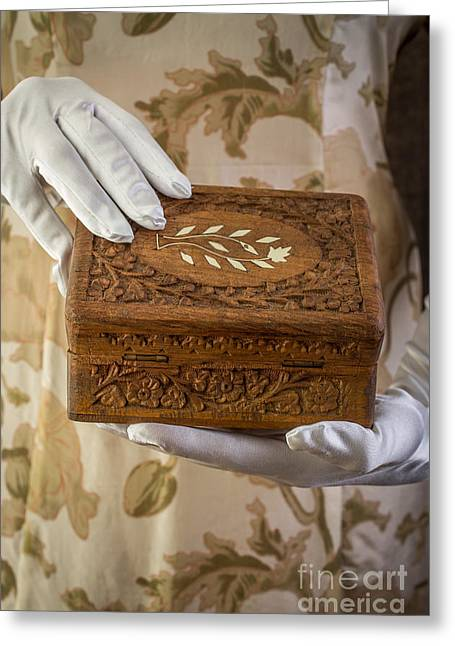 Flowered Greeting Cards - Woman in a dress opening a ornate box Greeting Card by Edward Fielding