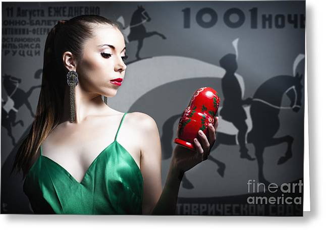 Hair Pulled Back Greeting Cards - Woman In Green Dress With Hair Tied Back Holding Russian Doll Greeting Card by Joe Fox