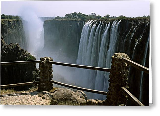 Zambezi River Greeting Cards - Woman Looking At The Victoria Falls Greeting Card by Panoramic Images