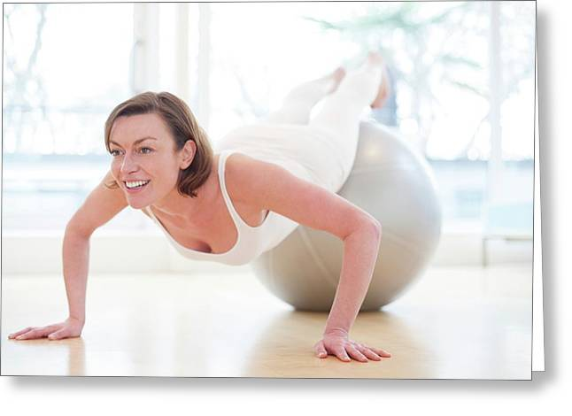 Woman On Exercise Ball Greeting Card by Ian Hooton