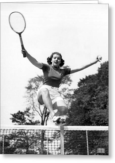 Sportswoman Greeting Cards - Woman Player Leaping Over Net Greeting Card by Underwood Archives