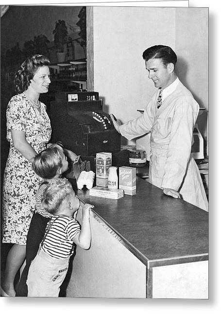 Woman Purchasing Groceries Greeting Card by Underwood Archives