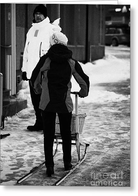 Scandanavian Greeting Cards - woman pushing kick sled out shopping on ice covered storgata main shopping street Honningsvag finnma Greeting Card by Joe Fox