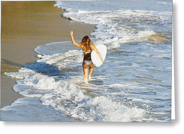 On The Beach Greeting Cards - Woman Running Along Beach Greeting Card by Ben Welsh