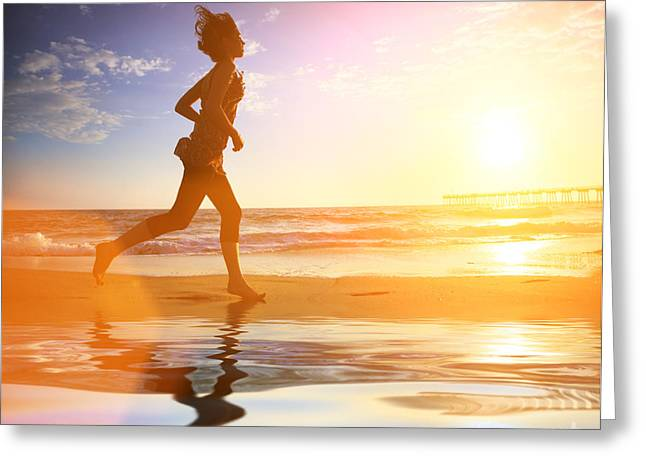 Ocean Vista Greeting Cards - Woman running by the ocean at sunset Greeting Card by Konstantin Sutyagin