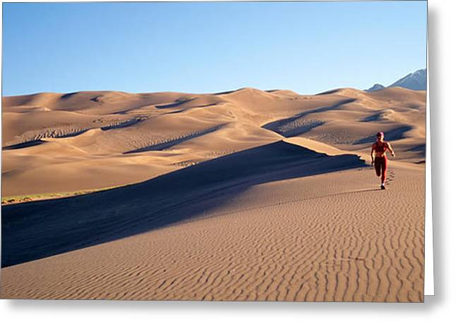 Colorado Sand Dunes Greeting Cards - Woman Running In The Desert, Great Sand Greeting Card by Panoramic Images