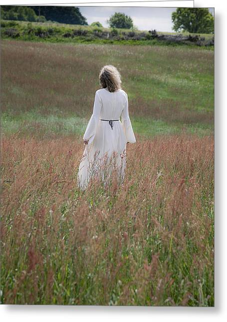 Woman In Summer Meadow Greeting Cards - Woman stands on a meadow Greeting Card by Maria Heyens