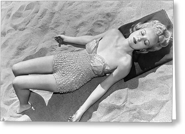 Woman Sun Bathing At The Beach Greeting Card by Underwood Archives