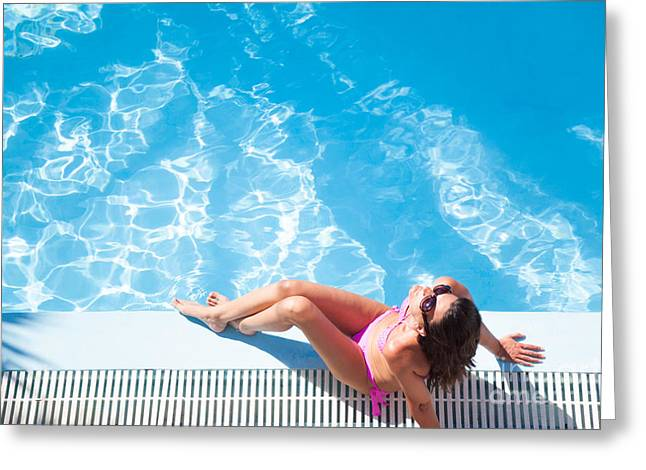 Suntanning Greeting Cards - Woman sunbathing by the swimming pool Greeting Card by Matteo Colombo